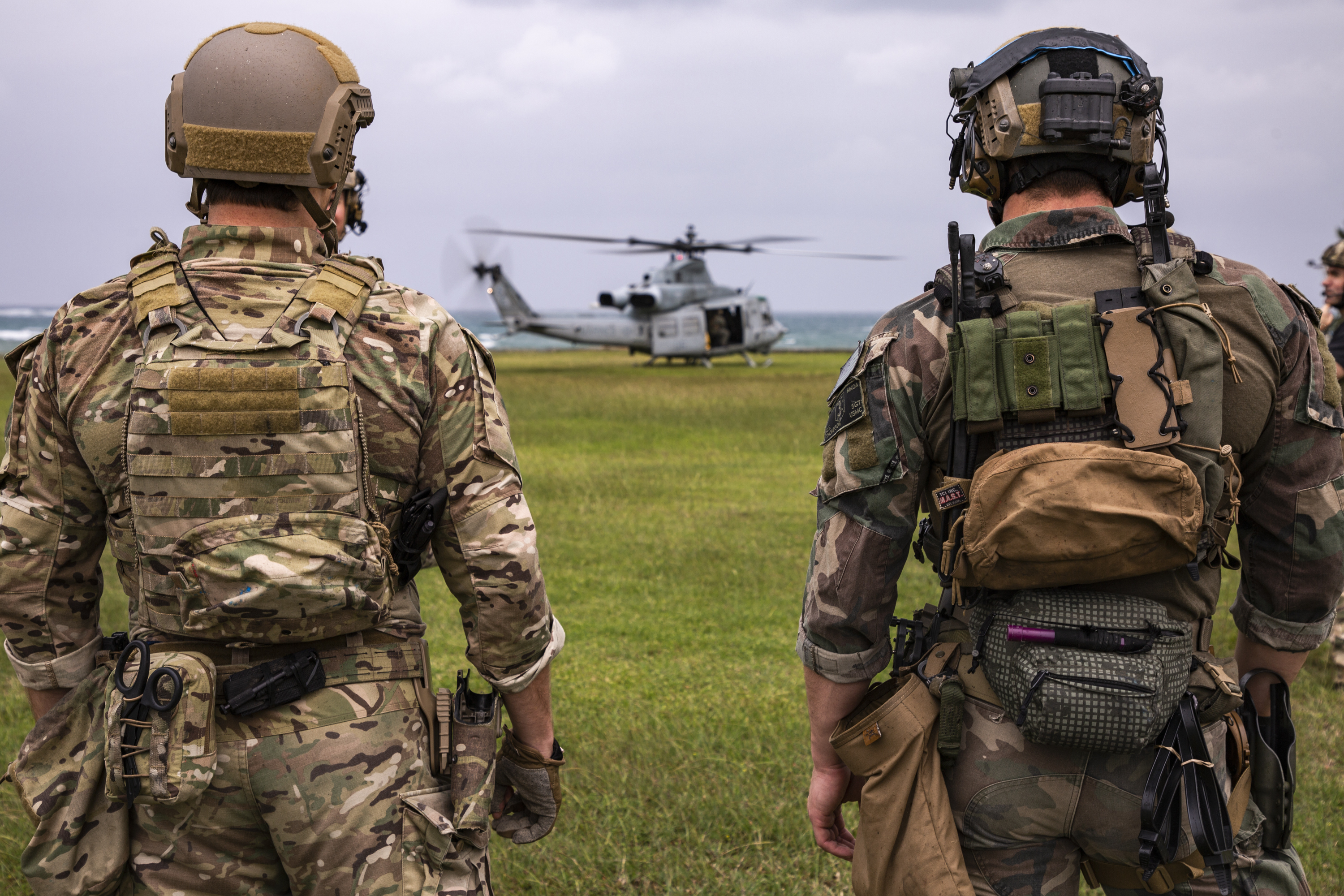U.S. Army Soldiers with Special Forces Group 1-1 and Marines from 3rd Marine Raider Battalion with Marine Light Attack Helicopter Squadron 469 (HMLA-469), conduct casualty evacuation drills at Torii Station, Okinawa, Japan, Oct. 23, 2020. This training maintains readiness, combat proficiency and enhances interoperability essential for joint and combined military operations in austere, expeditionary environments within the Indo-Pacific. (U.S. Marine Corps photo by Lance Cpl. Dalton J. Payne)