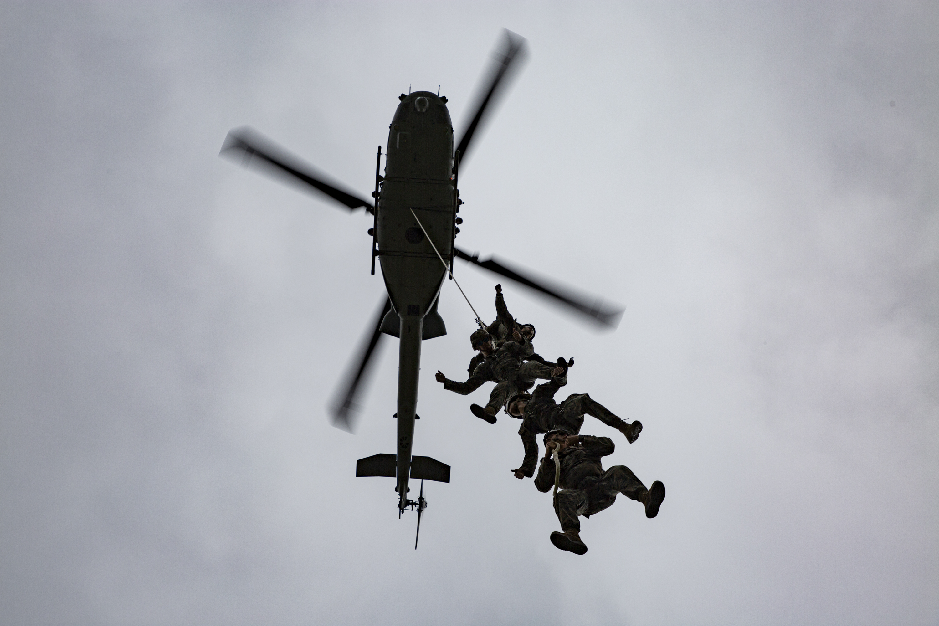 U.S. Marines with III Marine Expeditionary Force (III MEF), Expeditionary Operation Training Group (EOTG) with Marine Light Attack Helicopter Squadron 469 (HMLA-469), conduct special patrol insertion/extraction and helicopter rappel training at Camp Hansen, Okinawa, Japan, Oct. 23, 2020. EOTG trains Marines before being attached to Marine Expeditionary Units, where they will conduct operations using these techniques. (U.S. Marine Corps photo by Lance Cpl. Dalton J. Payne)