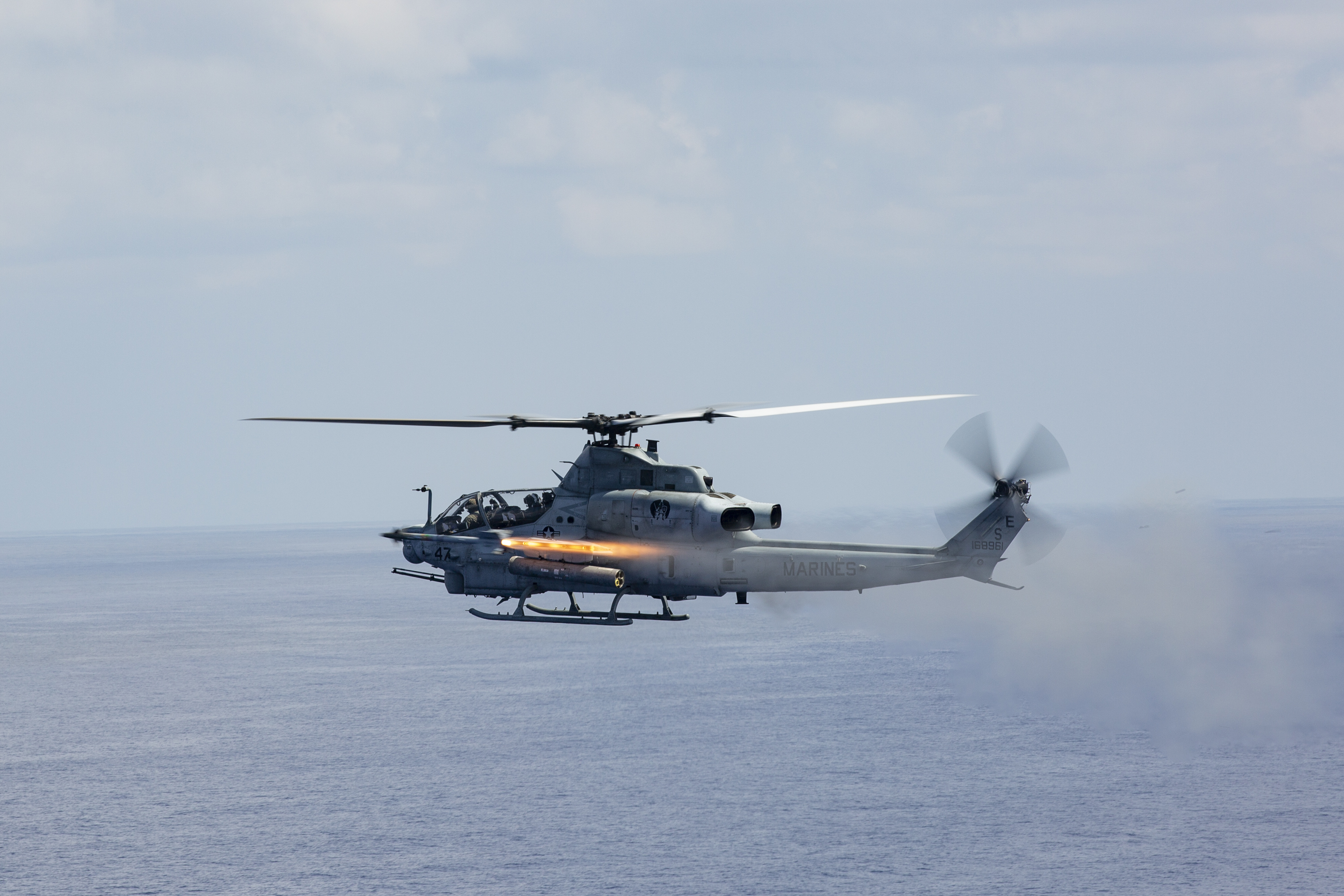 A U.S. Marine Corps AH-1Z Viper helicopter, with Marine Light Attack Helicopter Squadron (HMLA) 469, fires an Air Intercept Missile (AIM-9 Sidewinder missile) during a live-fire training event near Okinawa, Japan, Sept. 29, 2020. HMLA-469 conducted a live-fire exercise using AIM-9 Sidewinder missiles to improve proficiency with the weapon system. (U.S. Marine Corps photo by Cpl. Ethan M. LeBlanc)