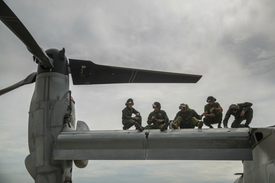 U.S. Marines conduct maintenance on an MV-22 Osprey